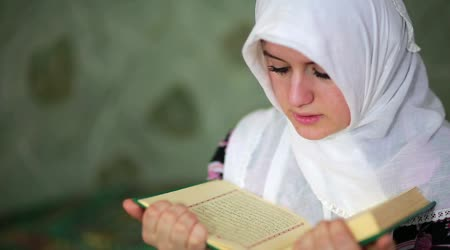depositphotos_38383029-stock-video-young-muslim-girl-reading-quran